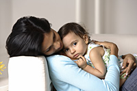 woman cradling baby - Asia Images Group