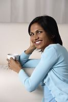 woman relaxing with a mug - Asia Images Group