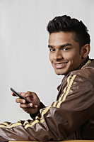 young man using mobile phone - Asia Images Group
