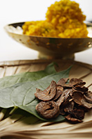 betel nut and leaves with chrysanthemums in background - Asia Images Group