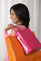 woman holding shopping bags - Asia Images Group