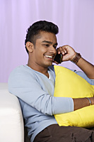 young man talking on mobile phone, relaxed - Asia Images Group