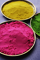pink, yellow and green Indian powder paints closeup - Asia Images Group
