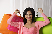 woman holding big shopping bags - Asia Images Group