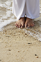 Close up of feet on the shore - Asia Images Group
