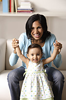 woman holding baby - Asia Images Group