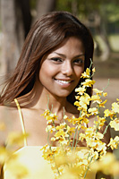 woman holding flowers, smiling - Asia Images Group