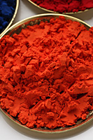 orange Indian powder paint closeup - Asia Images Group