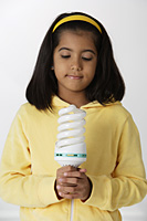 Girl holding light bulb - Asia Images Group