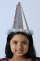 Little girl wearing birthday hat - Asia Images Group