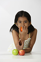 girl smelling orange - Asia Images Group
