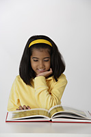 girl reading book - Asia Images Group
