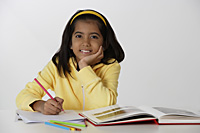 Girl working with color pencils and book - Asia Images Group