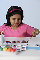 Little girl painting - Asia Images Group