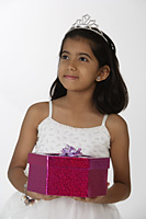 girl holding gift - Asia Images Group