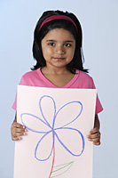Little girl holding picture of flower - Asia Images Group