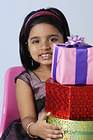 Little girl holding gifts - Asia Images Group