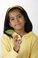 Girl holding leaf - Asia Images Group