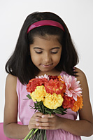 Girl holding bouquet of flowers - Asia Images Group