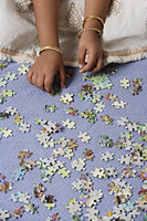 Hands of little girl working on puzzle - Asia Images Group