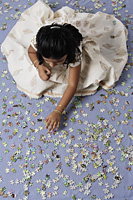 Little girl working on a puzzle - Asia Images Group