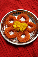 Indian sweets on silver tray. - Asia Images Group