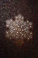 Close up of wood carving on Indian table. - Asia Images Group