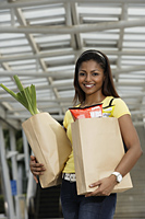woman holding grocery shopping bags - Asia Images Group