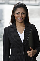 woman wearing business suit, holding folder - Asia Images Group