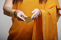 Cropped shot of woman wearing sari, holding credit card - Asia Images Group