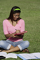 young woman studying outside - Asia Images Group