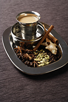 still life of masala tea and spices - Asia Images Group