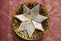 Indian sweets in star shape. - Asia Images Group