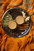 Indian masala tea with spices on silver tray. - Asia Images Group