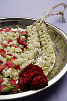 Flower garland on silver tray - Asia Images Group