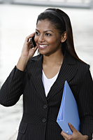 woman wearing business suit talking on phone - Asia Images Group