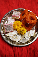 Assorted Indian sweets on silver tray. - Asia Images Group