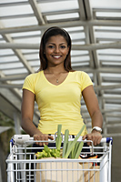 woman pushing shopping cart - Asia Images Group