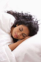 Head shot of Indian woman sleeping in bed - Asia Images Group