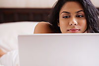 Closeup of Indian woman looking at computer - Asia Images Group