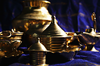 Still life of brass bowls and cups on table - Asia Images Group