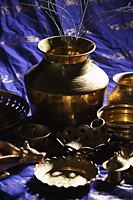 Still life of Indian bronze bowls and plates - Asia Images Group