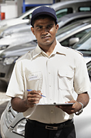 Security guard holding clipboard - Asia Images Group