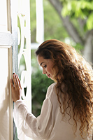 Profile of woman with long hair in doorway - Asia Images Group