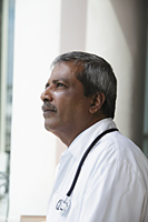 Head shot of Indian doctor looking up and thinking - Asia Images Group