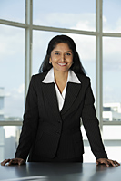 Indian woman standing at her desk - Asia Images Group