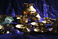 Still life of Indian brass bowls and cups on table - Asia Images Group