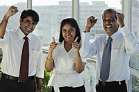 Three Indian people smiling making hand gestures - Asia Images Group