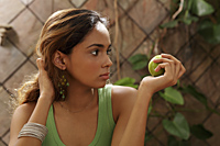 Young woman holding green apple - Asia Images Group