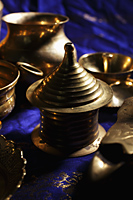 Close up of bronze Indian containers and bowls - Asia Images Group